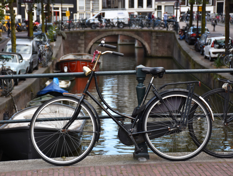 canva-amsterdam,-bike,-canal,-netherlands,-holland,-bridge-MACV3-0SFEI.jpg